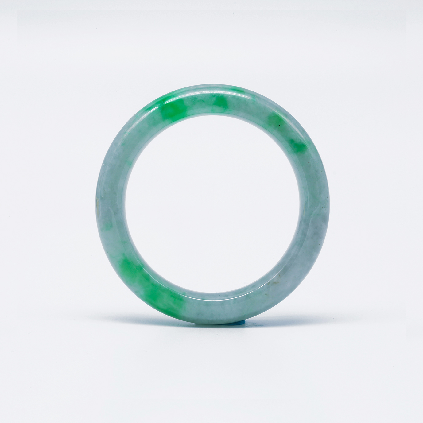 Splashes of Vibrant Green Jadeite Bangle